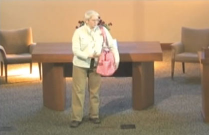 """Dementia-care made me a bag-lady,"" Mary explains to a group of seniors at Brooksby Village Chapel, in Peabody, MA"