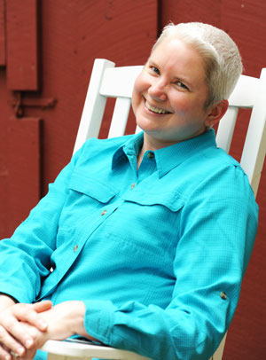 mary smiles on a rocking chair
