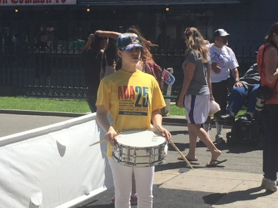 An ADA25Boston Volunteer Awaits Start with Snare and Sticks