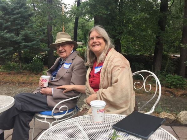 Jeanne Maurand of Hamilton and her father, Bob Yntema of Ipswich, relax in the garden at Rest.Stop.Ranch in Topsfield, MA.